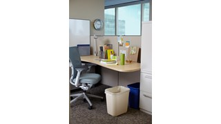 The Rubbermaid Commercial Fire-Resistant Wastebasket features a contemporary shape with a UL rating.