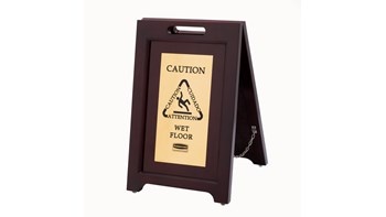 """Elegant, dark hardwood """"Caution"""" Sign is 2-sided for effective multilingual safety communication that won't disrupt a building's image."""