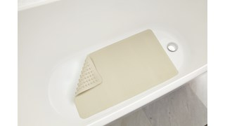 Safti-Grip® Bath Mat is perfect for a shower stall or bathtub. Suction-backed to stay firmly in place. Latex-free construction. Textured surface prevents slippage. Shower mat is perforated for improved drainage. Mildew-resistant.