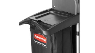 The Rubbermaid Commercial Waste Cover for High-Capacity Janitorial Cleaning Carts covers waste collection from guests and patrons.