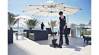 The Rubbermaid Commercial Executive Series Lobby Pro® Plastic Upright Dust Pan with Cover is ideal for use in your hotel lobby, restaurant lobby, or banquet hall.